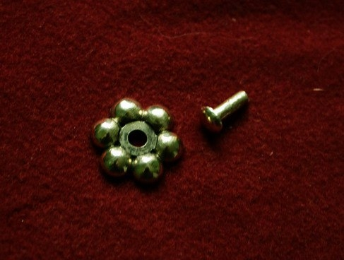 Cast rosette with rivet  tn16