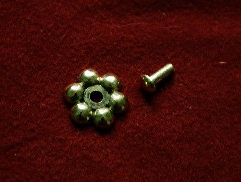 Cast rosette with rivet  tn16